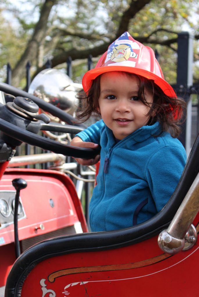 Child with fire helmet