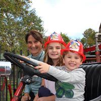 Two children in plastic fire helmets