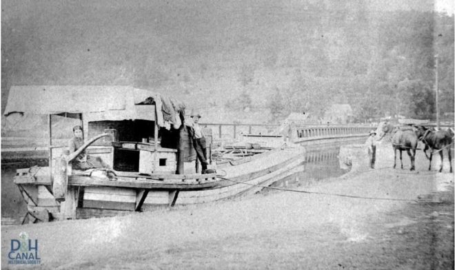 Florence, Philip, and Ralph DeGroodt and their D&H Canal boat waiting to enter a Roebling aqueduct c1895.